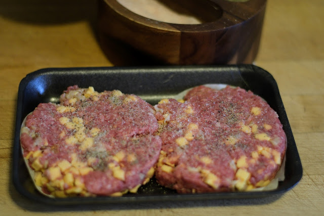 The bacon cheddar patties seasoned with salt and pepper.