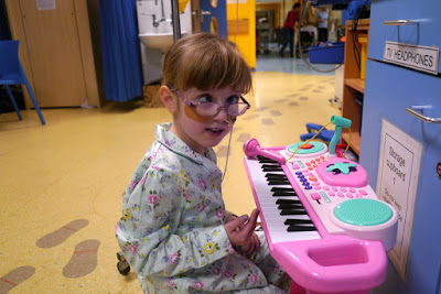 Jessica playing the toy piano on the ward