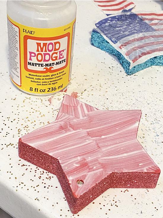 Mod Podge on the star for a napkin