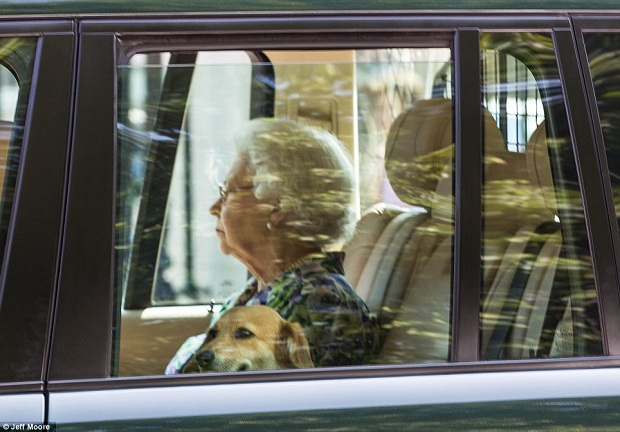 The Queen arrives at The Buckingham Palace and awaits the news of the birth!