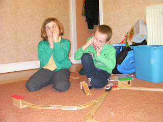 kids wooden train track pulling faces