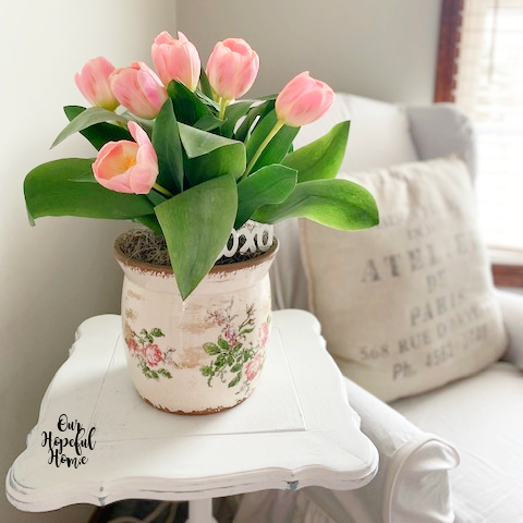 floral cache pot artificial pink tulips white side table