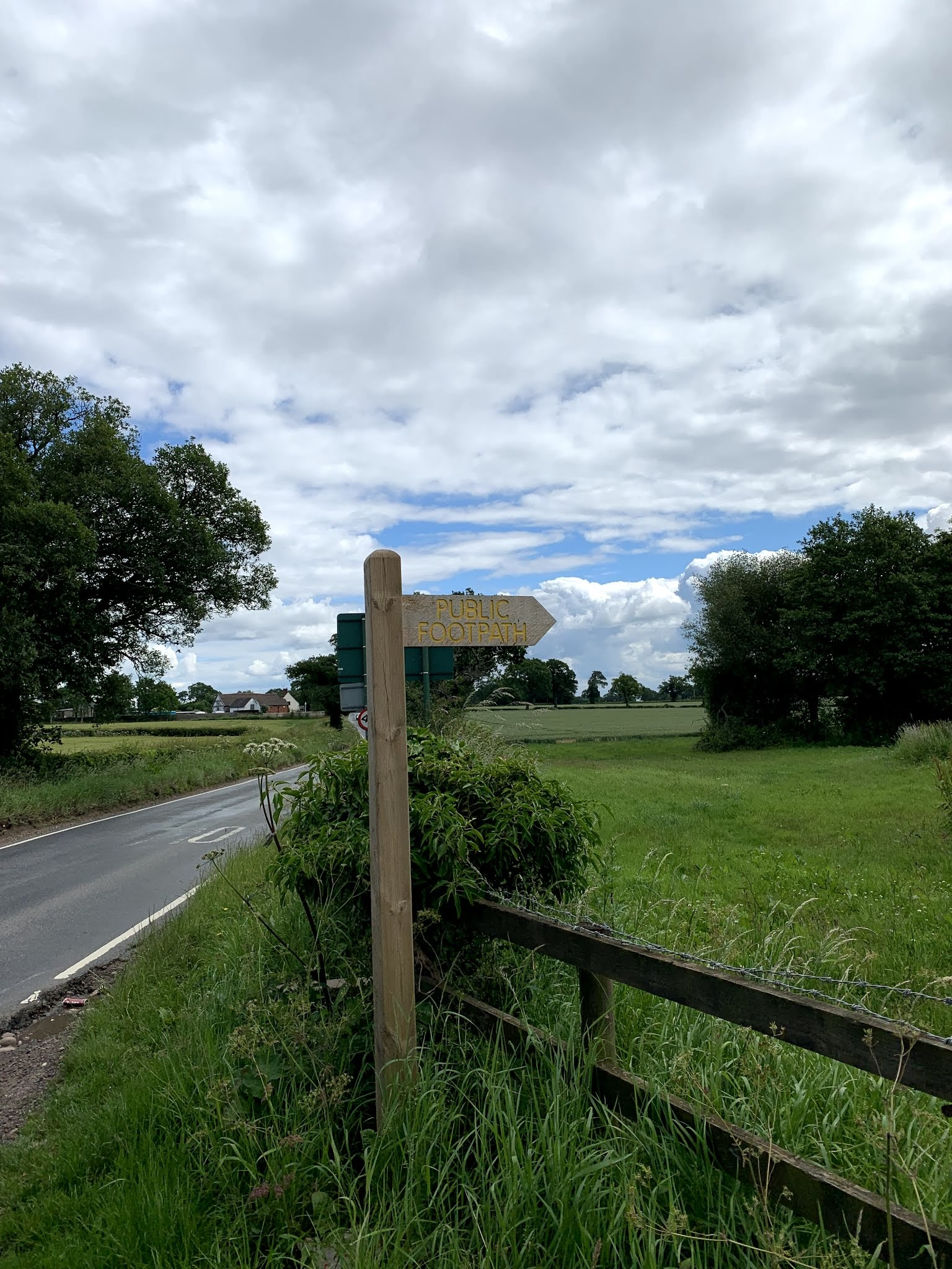public footpath sign by road
