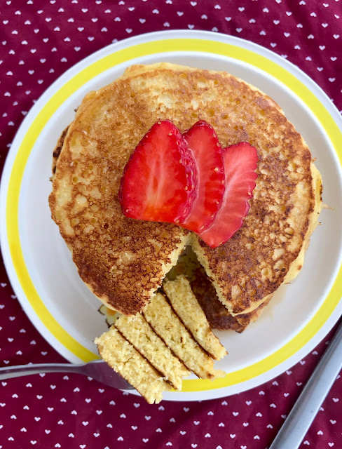 Old-fashioned cornmeal griddle cakes are pancakes made with cornmeal and topped with real maple syrup.