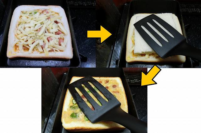 溶き卵を入れたら弱火~中火の間に火を弱め、溶き卵のフチがかたまり始めたらチーズを卵の上にまんべんなく散らし、すぐくり抜いた食パンの白い方をかぶせます。 フライ返しで上からギュッと押さえつけて密着させます。  軽く食パンをフライ返しで持ち上げて卵が固まっていたらひっくり返し、2分程度焼いたら完成です。
