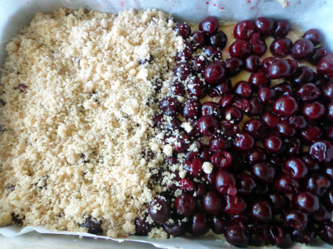 Sour cherry crumb cake by Laka kuharica: Top with cherries, and sprinkle with crumb topping.