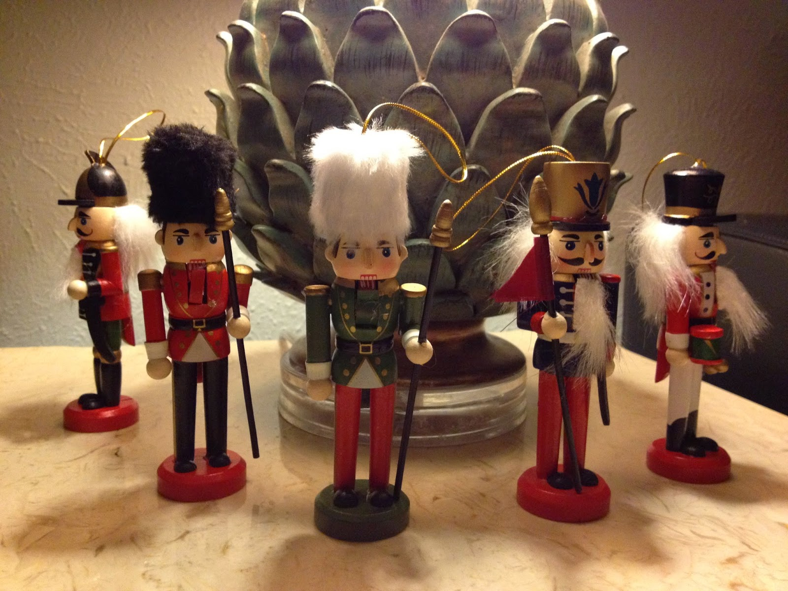 squad of miniature nutcrackers guarding a giant pineapple