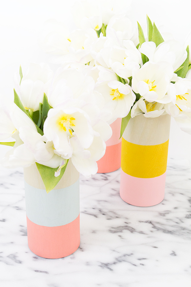 http://sarahhearts.com/2015-02-02/diy-color-blocked-wood-vases/