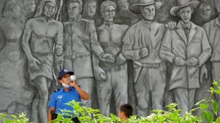 Nicaragua police officer drinks