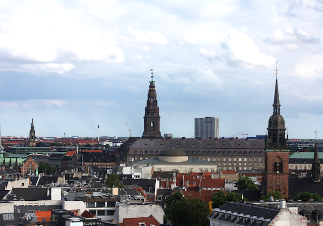 The crown spire tops Christiansborg Palace in the distance seen from the observatory deck at The Round Tower.