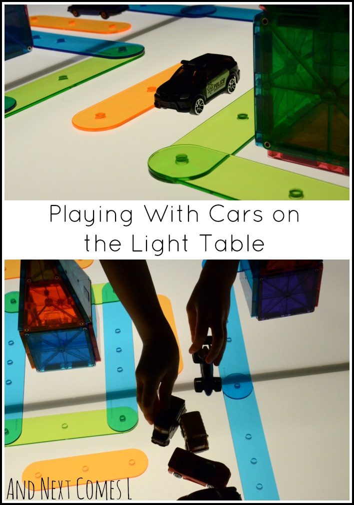 Playing with cars and building a translucent city on the light table to encourage imaginative play from And Next Comes L