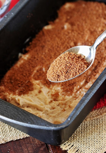 Sprinkling Cinnamon Sugar on Snickerdoodle Bread Batter Image