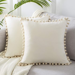 cream pom pom pillow
