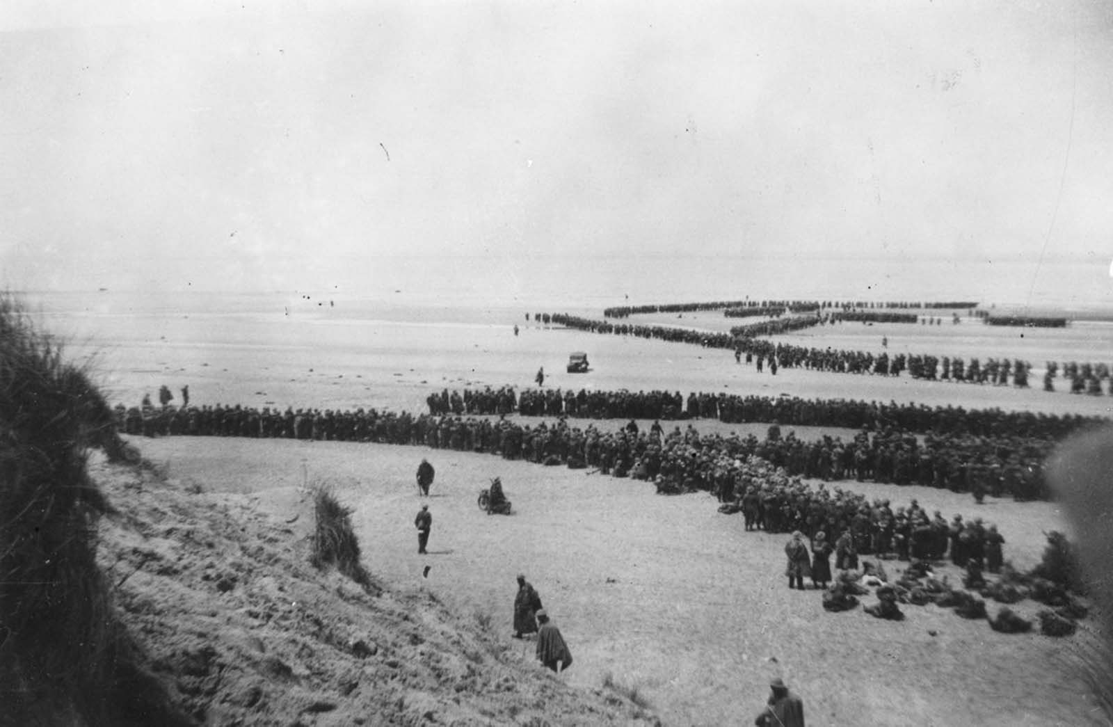 British Expeditionary Forces queued up on the beach at Dunkirk as they await evacuation.