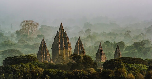 Prambanan temple in foggy sky morning