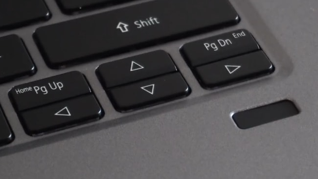 Small and very closely placed 4 arrow keys.