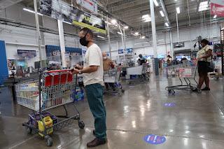 shoppers inside Pricesmart, Escazu
