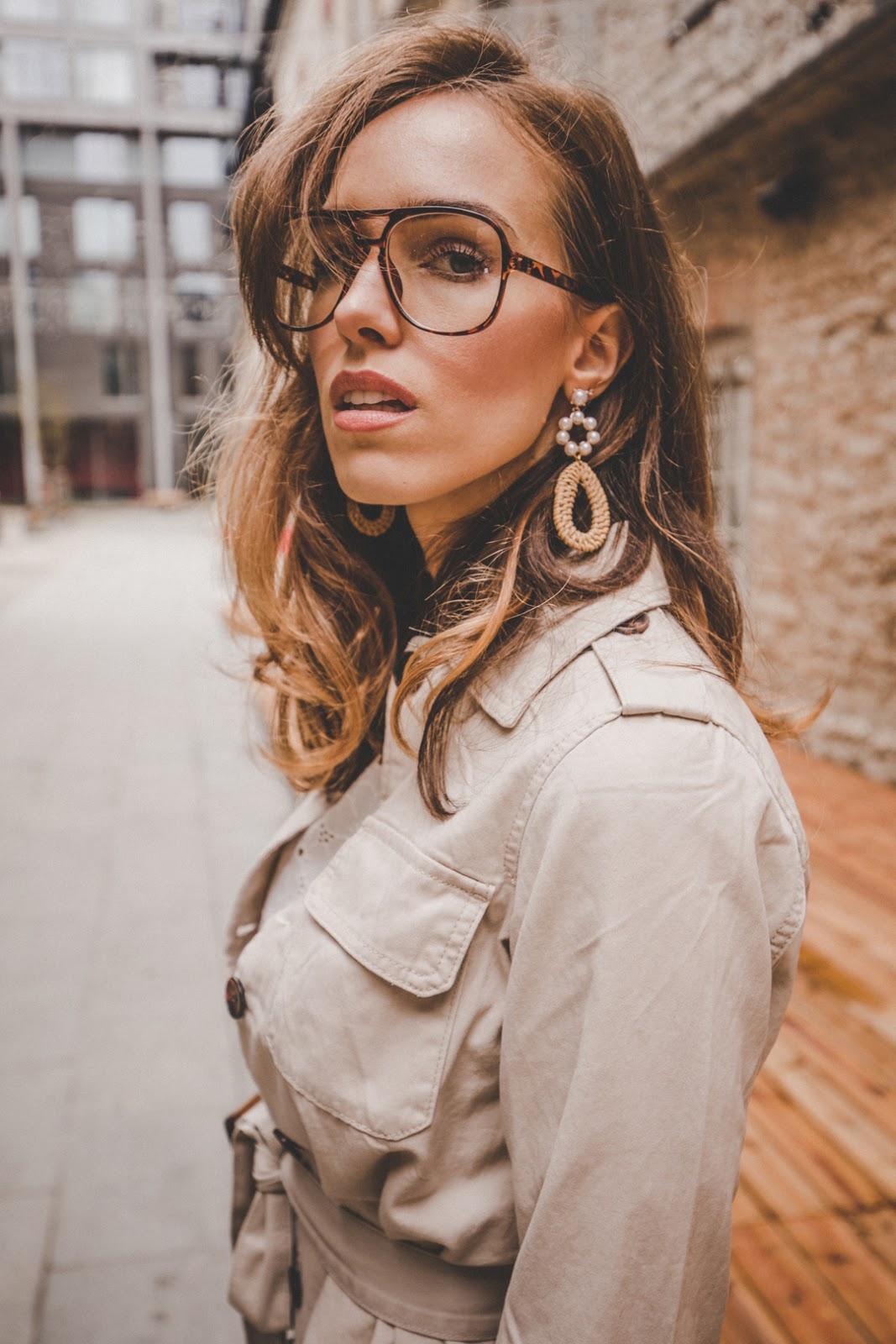 beige safari jacket retro glasses raffia earrings
