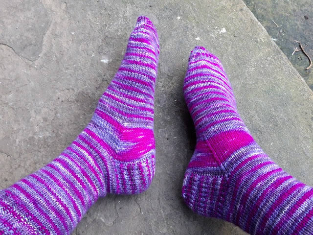 The same pair of socks at a different angle on the flagstone