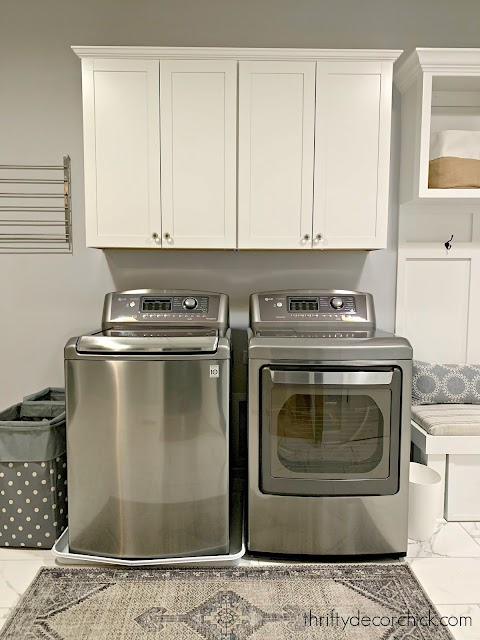 washer and dryer with cabinets above