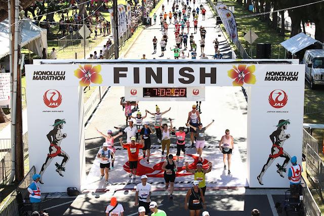 Runners at the finish line at Kapiolani Park Honolulu Marathon