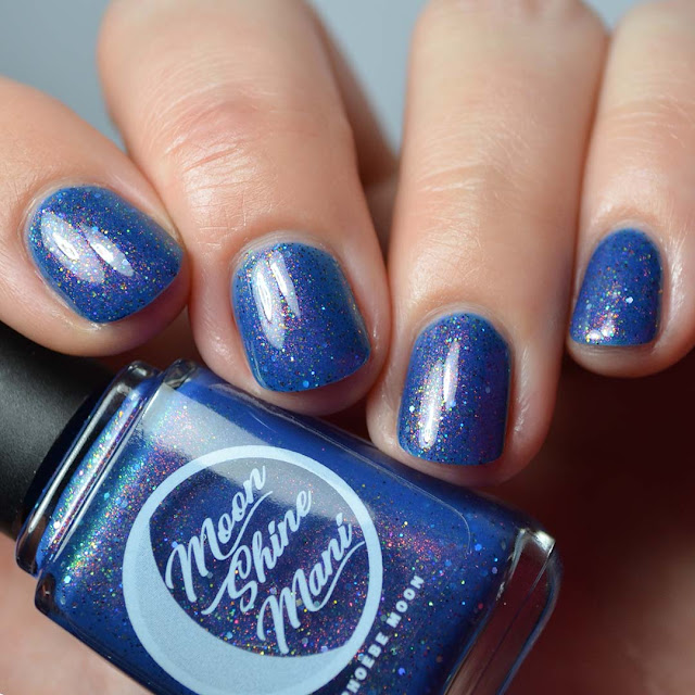blue crelly nail polish with iridescent microglitter