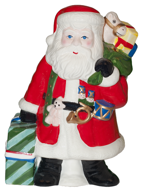 A big ceramic cookie jar shaped like Santa Clause carrying a large Christmas gift in one hand, and a sack of toys in the other hand.