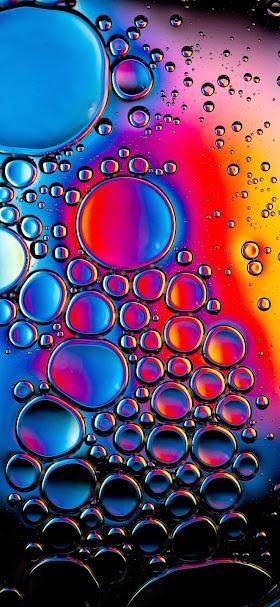 خلفية فقاعات هواء داخل سائل ملون