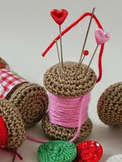 http://www.ravelry.com/patterns/library/yarn-spool-pincushion
