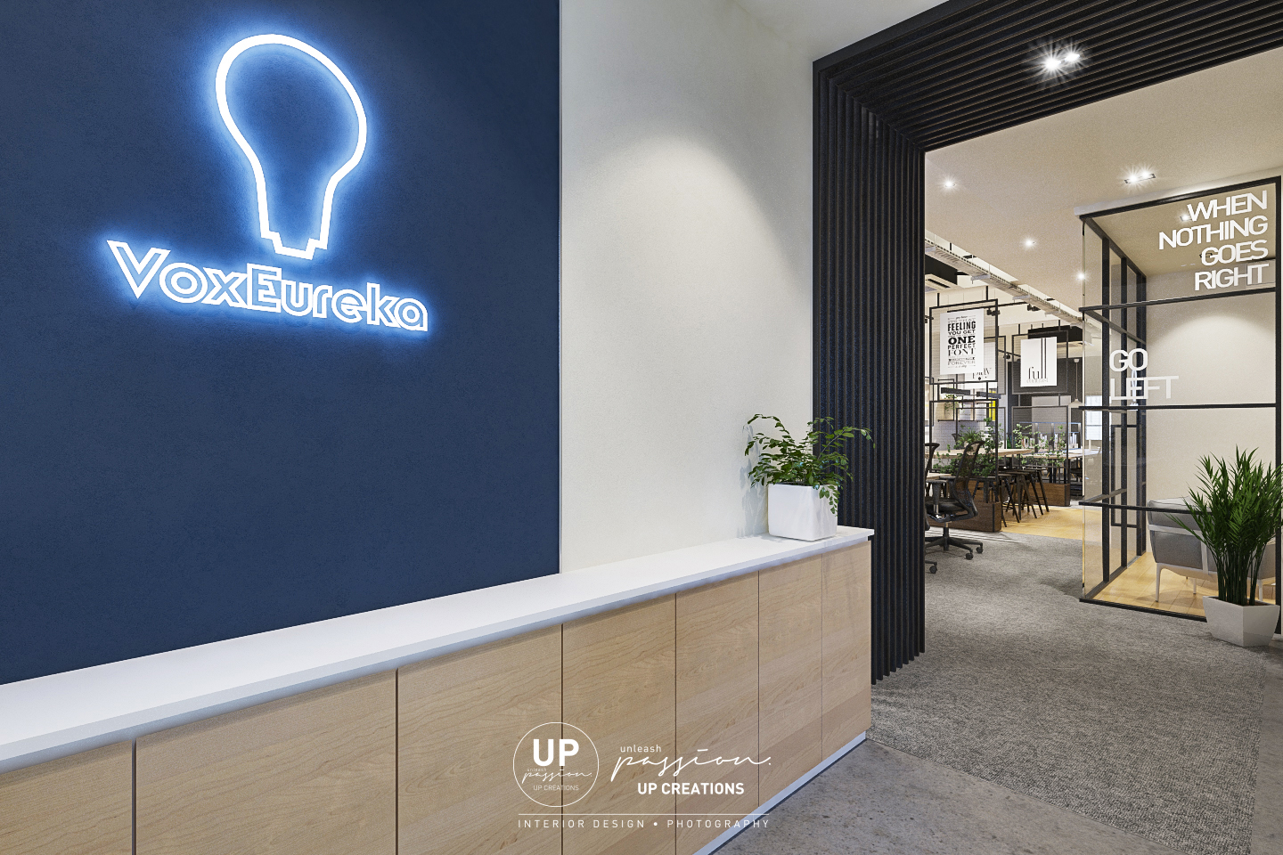 Subang vox eureka office entrance foyer with highlight dark blue wall with led neon signage and black color wood strips arch to enter the working area