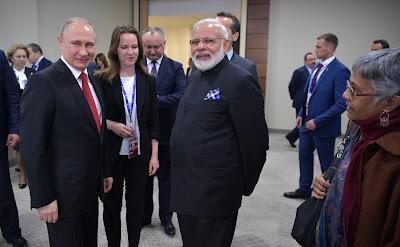 Vladimir Putin, Narendra Modi.