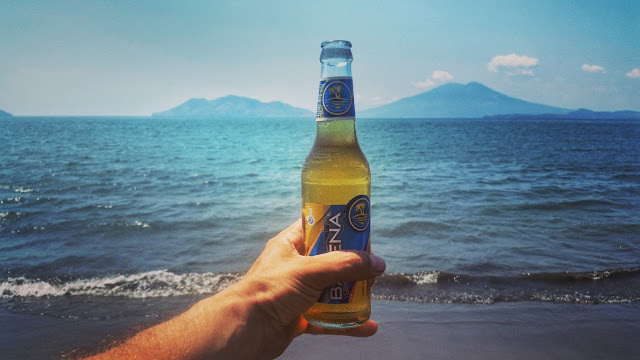 a Barena beer at the beach of tiger island in Honduras