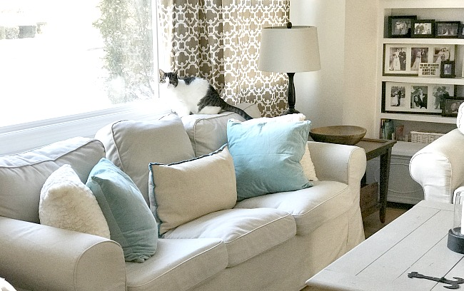 White couch with blue pillows