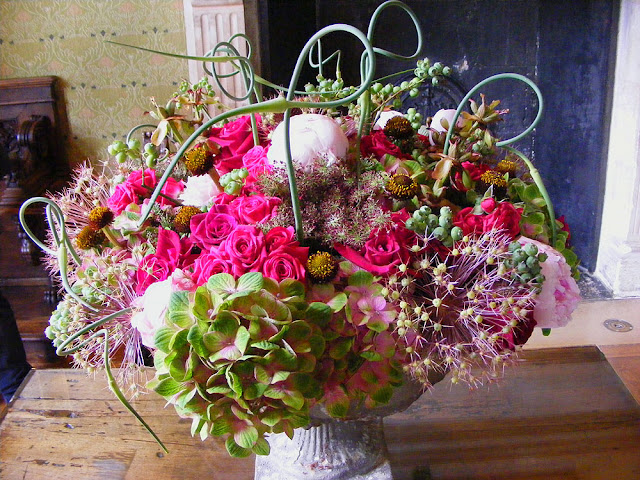 Flower arrangement, Chateau de Chenonceau.  Indre et Loire, France. Photographed by Susan Walter. Tour the Loire Valley with a classic car and a private guide.