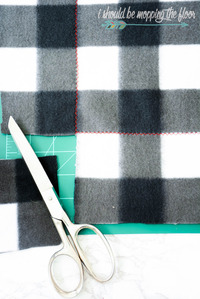 "Easy Sew Blanket and Coordinating Tags | Make this simple buffalo check blanket and download the coordinating ""warm and cozy"" gift tags for the perfect present!"