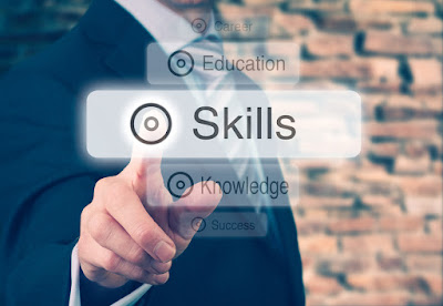 "A man points to the word ""Skills"""