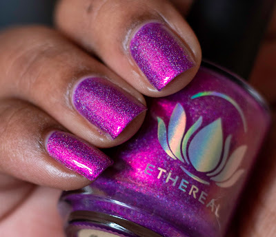 violet shimmer polish with holographic flakies on dark skin