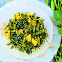 For making Stir fried water spinach or kolmou bhaji collect tender shoots of water spinach. Fry in mustard oil with garlic cloves.