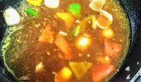 Capsicum onion red yellow bell peppers in soya chilli gravy