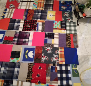 arrange fleece fabric stripes for patchwork blanket