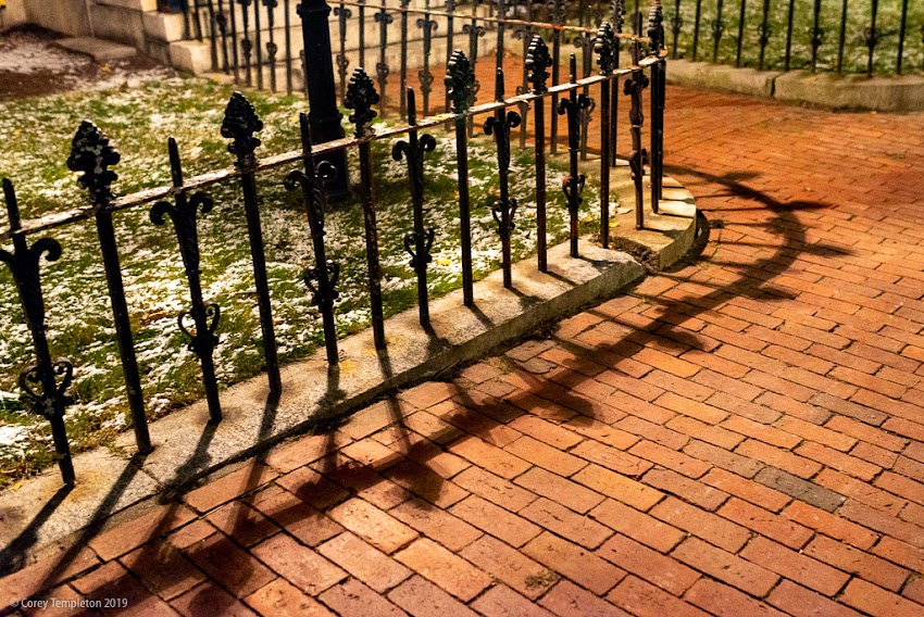 Portland, Maine USA November 2019 photo by Corey Templeton. An ornate fence and its reflection on Brackett Street.