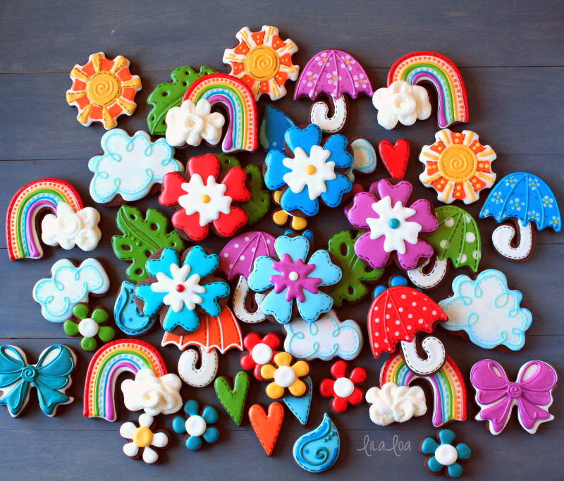 April showers decorated sugar cookies - brightly colored flowers and rainbow chocolate cookies