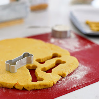 Making homeamde dog treats with bone shaped cookie cutter