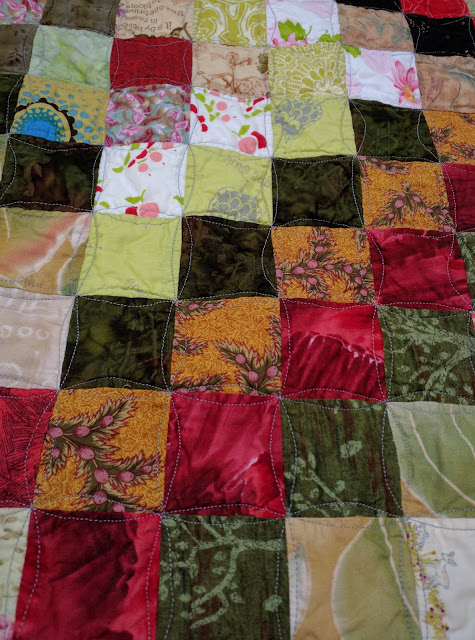 Orange peel curved free motion quilting on Scrappy Trip Around the World quilt