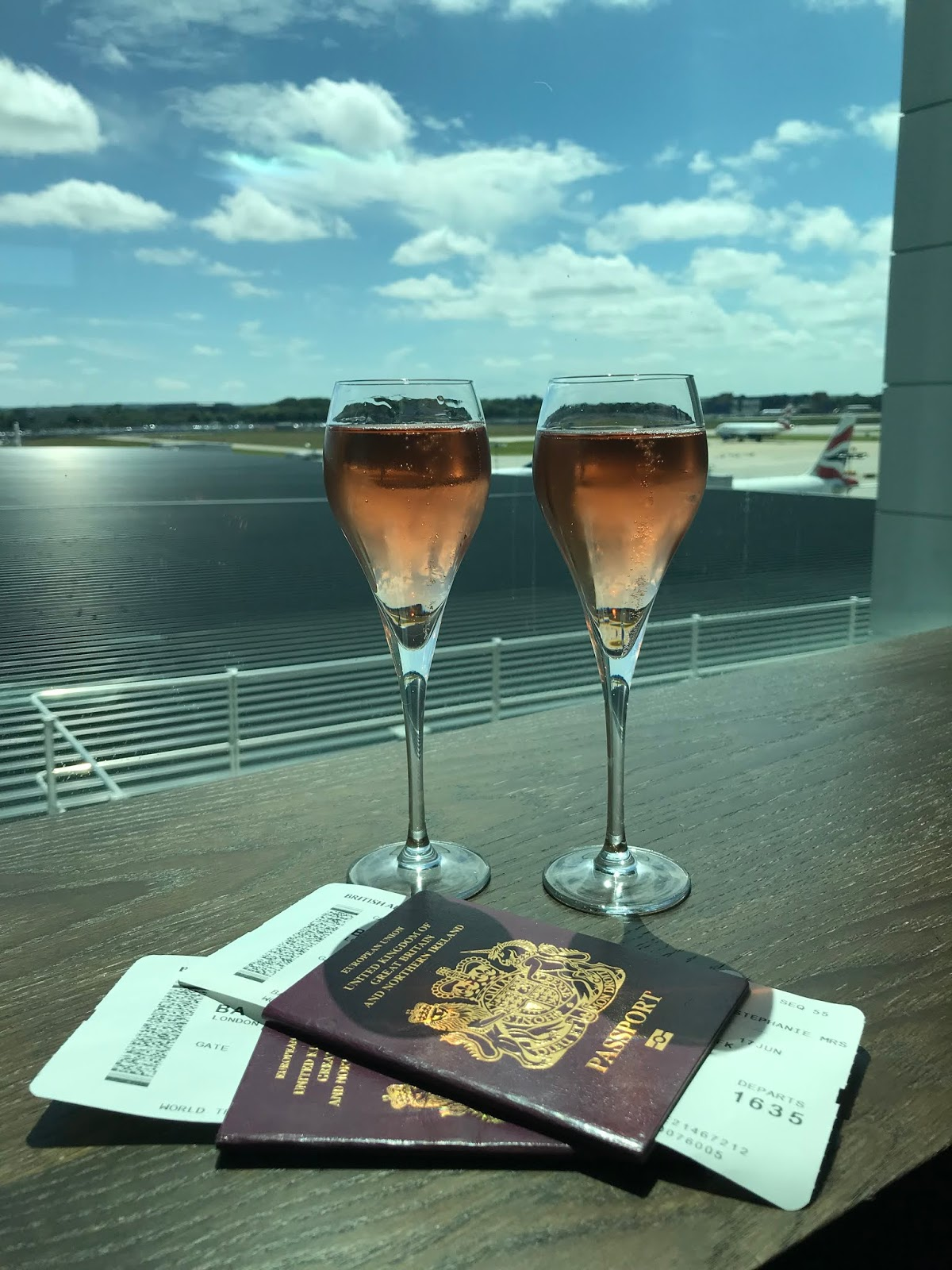 Gatwick airport lounge ready for take off to New York with champagne and a view