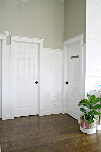 white shiplap walls around doors