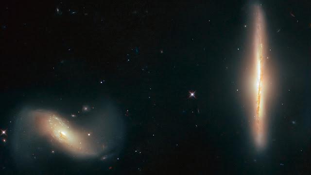 El telescopio Hubble capta a dos galaxias distorsionadas y difuminadas fruto de su gravedad
