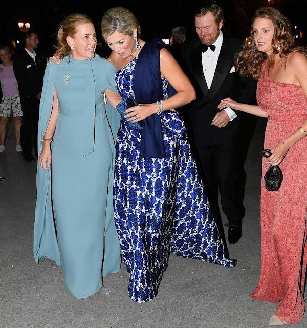 Queen Maxima attended the wedding reception. Carolina Herrera floral print dress