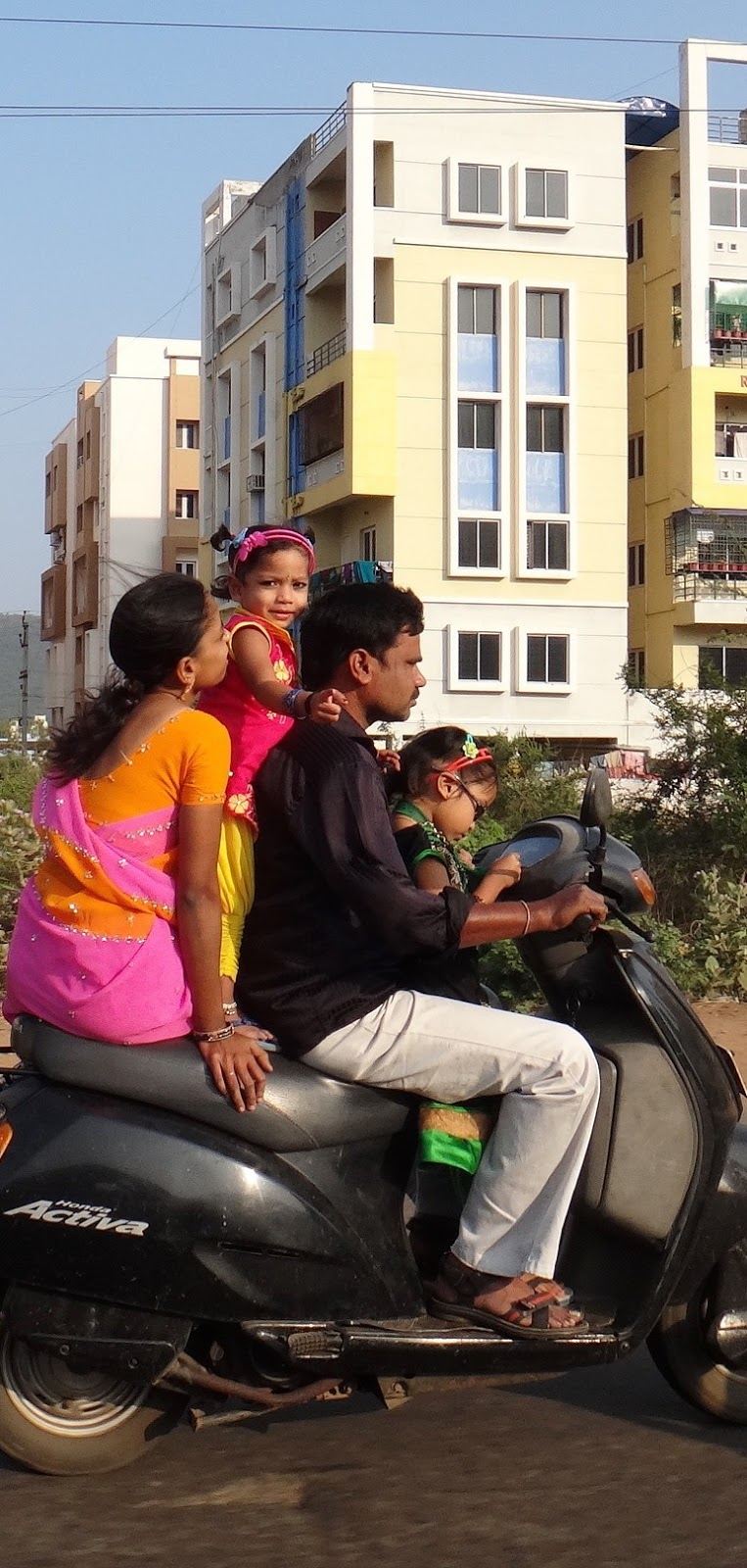 Family on a scooter.