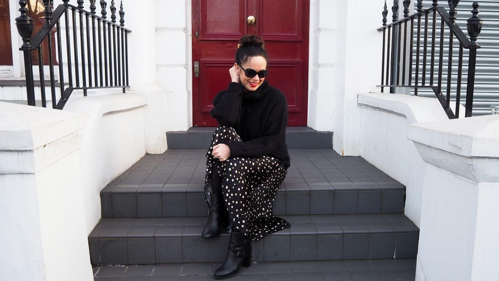 black turtleneck jumper and satin polka dot skirt with boots